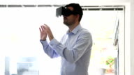 Virtual reality headet worn by man video