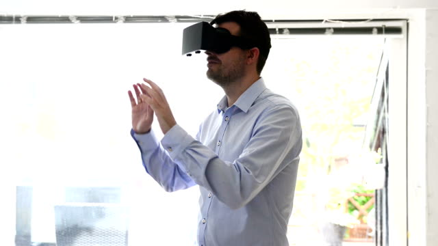 Virtual reality headet worn by man video