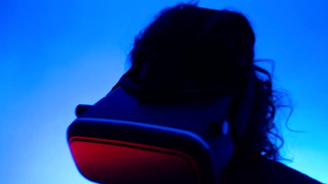 VR virtual reality smart phone modern glasses girl interacting video