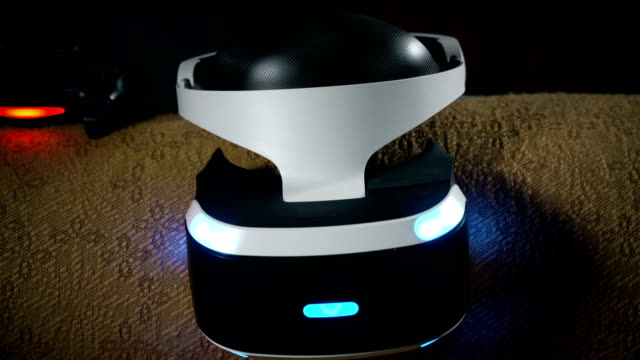 Virtual reality VR headset and wireless gaming controller on chair in the room video