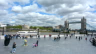 Visitors at the south bank with the Tower Bridge in London and the Tower of London in London England, UK video