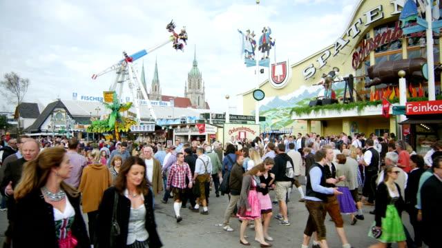 Visitors Walking Through Oktoberfest Fairgrounds (4K/UHD to HD) video