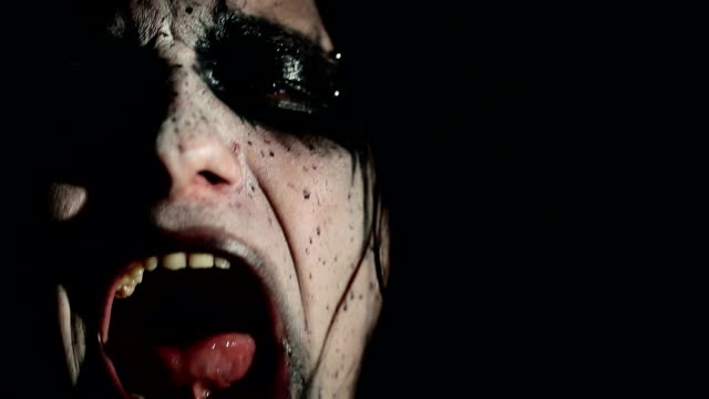 Vocalist of black metal band. Close up face video