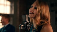 Vocalist with bright make up perform on stage at microphone. Singing. Jazz video