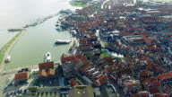 Volendam town in North Holland Flying Over Redtop Homes Slowly Descending video