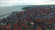 Volendam town in North Holland in the Netherlands Aerial Flyover Of Homes video
