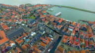 Volendam town in North Holland in the Netherlands Aerial View Of Homes & Boats video