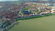 Volendam town in North Holland Over Green Water View Of Beach Front Homes video