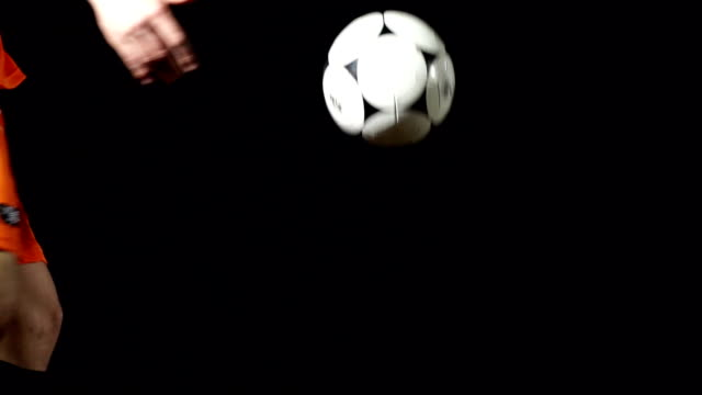 Volleying a Football / Soccer ball, Super Slow Motion video