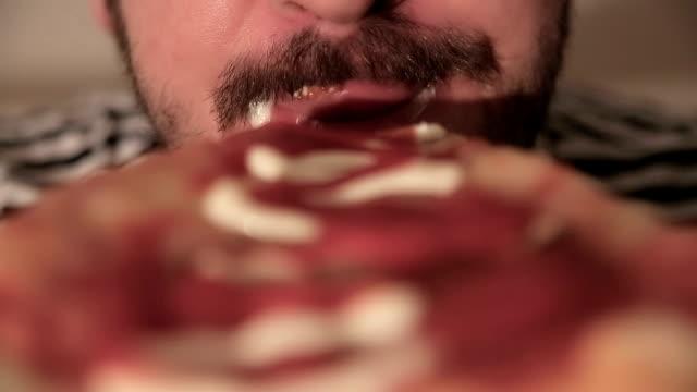 voracious man eating pizza,close up video