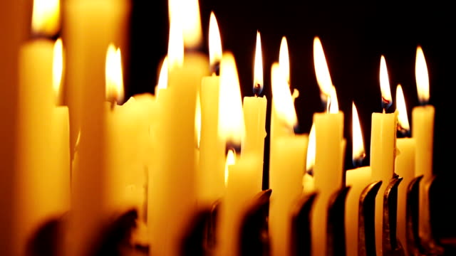 Votive candles burning in a church video