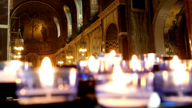 Votive candles in a catholic cathedral. video
