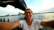 vYoung woman takes a selfie with Sydney skyline on background video