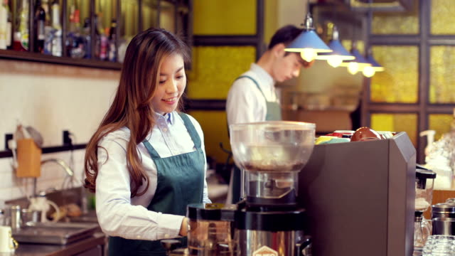waiter and waitress in modern cafe video