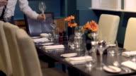 MS TU Waiter arranging dining table in restaurant video