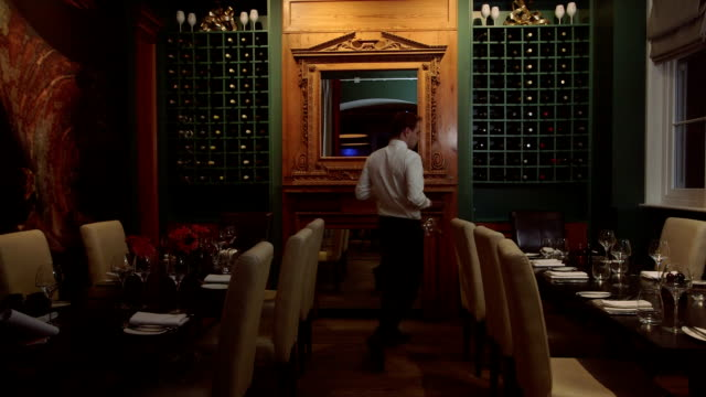 MS Waiter arranging dining table in restaurant video