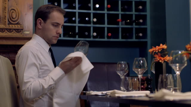 MS Waiter cleaning wine glass in restaurant video