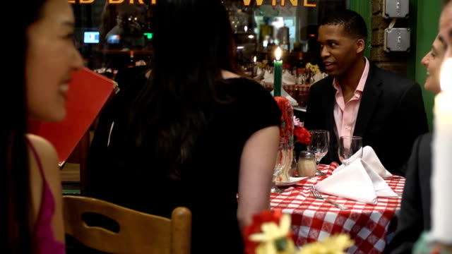 Waiter Giving Menus to Friends at Table video