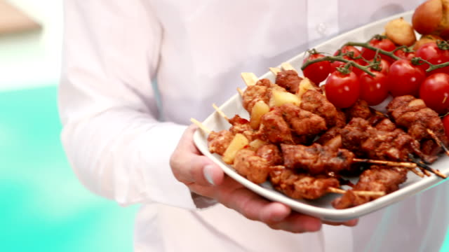 Waiter holding a plate of delicious food video