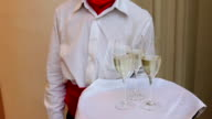 Waiter holds tray with glasses of champagne video
