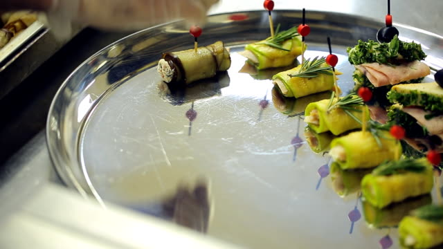 Waiter is serving plate with canape and appetizers video