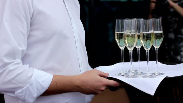 Waiter offer a glass of champagne video