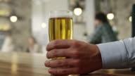 Waiter picking up glasses of beer video