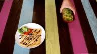Waiter put pancakes to table video