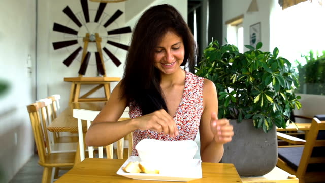 Waiter serve cheese pizza to happy woman video