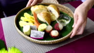 Waiter serve morning breakfast with tropical fruit, croissant, pancake and honey video