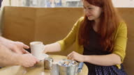 Waiter Serving Coffee to Female Customer video