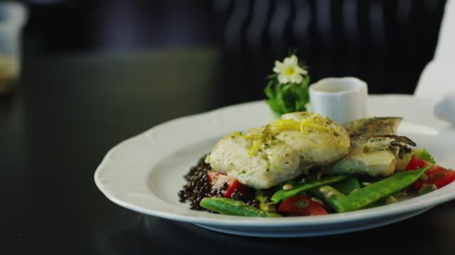 Waiter Serving Fried Fish Dish in Luxury Restaurant video