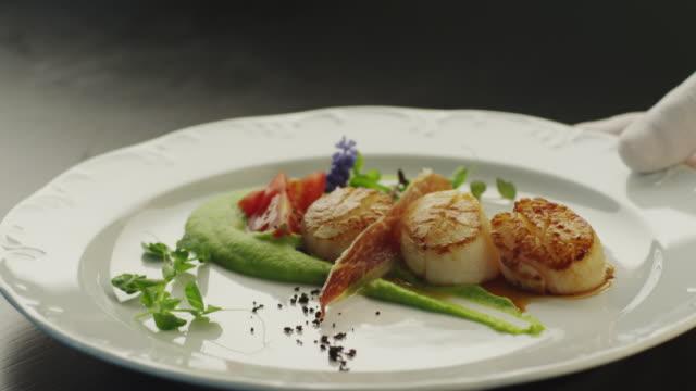 Waiter Serving Fried Fish Steak in Luxury Restaurant video