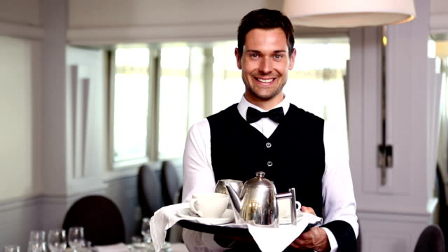Waiter showing a tea tray video