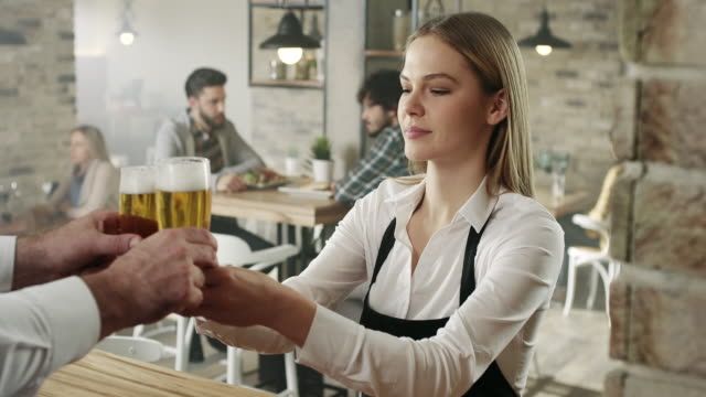 Waitress picking up a beer video