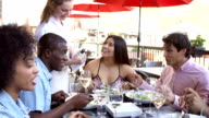 Waitress Pouring Wine For Group Of Friends At Restaurant video
