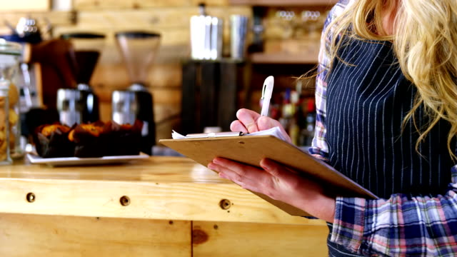Waitress preparing checklist video