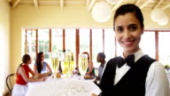 Waitress serving champagne to costumer video