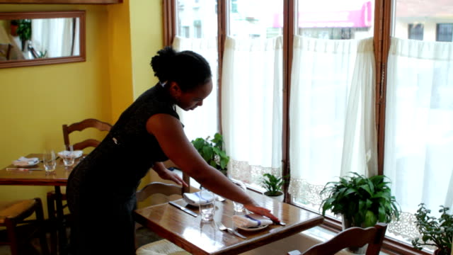 Waitress setting up table video
