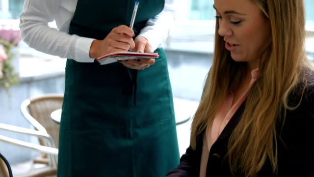 Waitress taking an order in cafe video