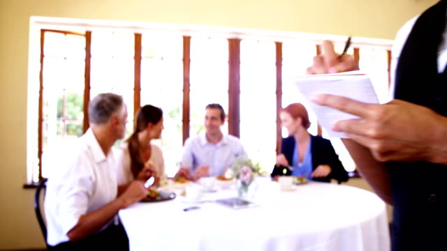 Waitress taking order in restaurant video