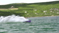 SLOW MOTION: Wakeboarder extreme jumping video