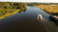 Wakeboarder surfing on the river.Aerial video video