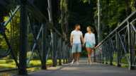 Walk across the bridge of love in the park. video