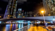 Walk on promenade of Dubai Marina with view of Towers and canal in Dubai night timelapse hyperlapse video
