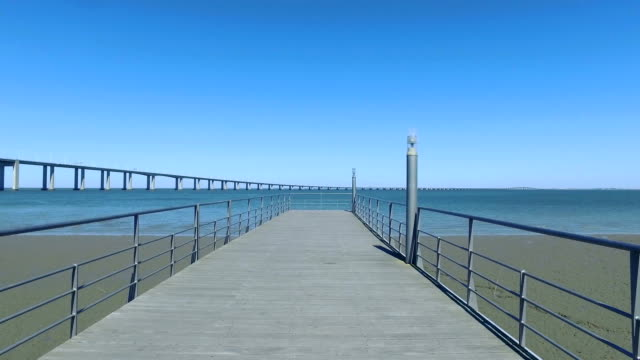 Walk on the Pier Near the Vasco da Gama Bridge video