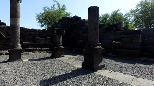 Walking Among Old Black Columns in Ruins video