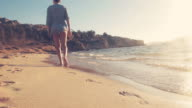 Walking and meditating on the beach. video