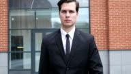 Walking Businessman Outside Office Building video