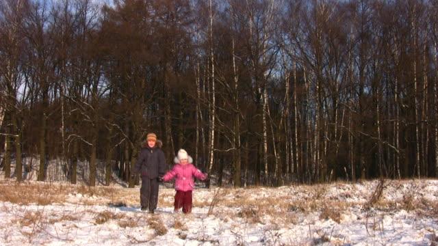 Walking children in winter park video